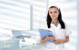 Nurse in clinic waiting room. Portrait of smiling nurse in clinic waiting room, healthcare, medical Royalty Free Stock Image