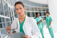 Nurse with clipboard Stock Images