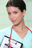 Nurse with clipboard and stethoscope Royalty Free Stock Image