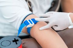 Nurse collecting a blood from patient in hospital.  stock images