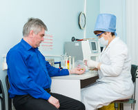 Nurse collects blood for test Royalty Free Stock Photo