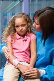 Nurse comforting anxious girl Royalty Free Stock Image