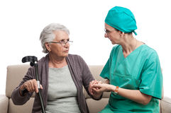 Nurse comforting old woman Royalty Free Stock Images