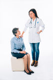 Nurse comforting a patient Royalty Free Stock Images