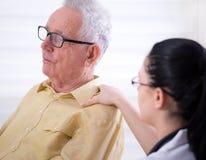 Nurse comforting senior man Royalty Free Stock Photography