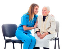 Nurse consoling worried patient Royalty Free Stock Photo