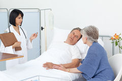 Nurse with a couple in a hospital Stock Image