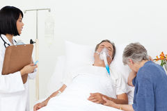 Nurse with a couple in a hospital Stock Photography