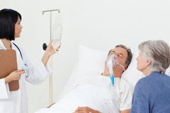 Nurse with a couple in a hospital Stock Photos