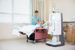 Nurse Covering Patient Receiving Renal Dialysis stock photos