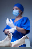 Nurse and dead body in morgue. Vertical Royalty Free Stock Photography