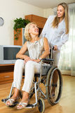 Nurse and disabled woman on chair Royalty Free Stock Photography