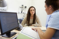 Nurse Discussing Test Results With Patient Stock Images