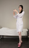 Nurse with a disposable syringe Stock Photo
