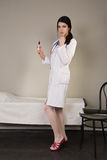 Nurse with a disposable syringe Stock Images