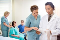 Nurse and Doctor with CTG report Royalty Free Stock Image
