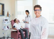 Nurse With Doctor Examining Patient's Heartbeat In Stock Photos