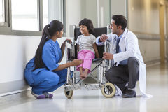 Nurse Doctor and Female Girl Child Hospital Patient in Wheelchai Royalty Free Stock Images
