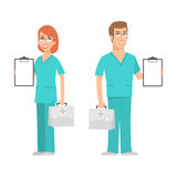Nurse and doctor holding suitcase and smiling Stock Photos