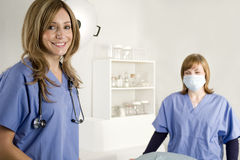 Nurse and doctor in hospital room Stock Photo