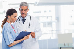 Nurse and doctor looking a file Stock Photography