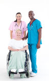 Nurse and doctor looking after a patient Stock Images