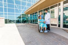 Nurse And Doctor Looking At Patient On Wheelchair Royalty Free Stock Image