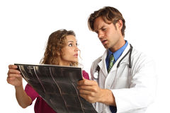 Nurse and doctor looking at x rays with bad news Stock Photography