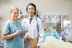Nurse And Doctor With Patient Resting In Hospital Stock Photography