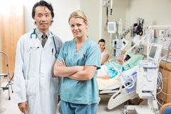 Nurse And Doctor With Patient Resting In Stock Photo