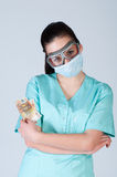 Nurse or doctor in pilot glasses with mask and money Royalty Free Stock Photography