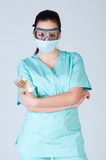 Nurse or doctor in pilot glasses with mask and money Stock Images