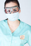 Nurse or doctor in pilot glasses with mask and money Stock Image
