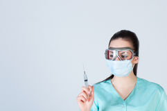 Nurse or doctor in pilot glasses with syringe and mask Stock Images