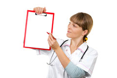 Nurse / doctor showing blank clipboard sign Royalty Free Stock Images