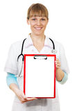 Nurse / doctor showing blank clipboard sign Stock Photos