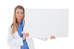 Nurse / doctor showing blank clipboard sign. Stock Image