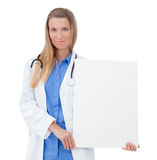 Nurse / doctor showing blank clipboard sign. Stock Photos