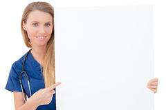Nurse / doctor showing blank clipboard sign. Stock Images