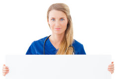 Nurse / doctor showing blank clipboard sign. Stock Photo