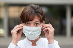 Nurse or doctor wearing a face mask outdoors Royalty Free Stock Images
