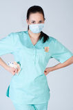 Nurse or doctor wearing  mask and holding money Royalty Free Stock Photos