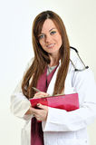Nurse or doctor - woman - writing Stock Photo