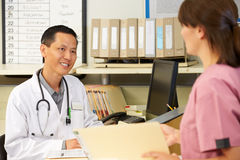 Nurse With Doctor Working At Nurses Station Royalty Free Stock Photos