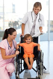 Nurse and doctor with a young patient Royalty Free Stock Photos
