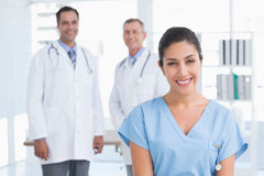 Nurse and doctors smiling at camera Stock Images