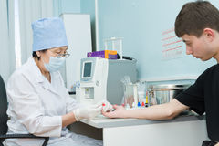 Nurse draws blood for test Stock Photos