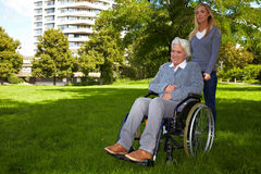 Nurse driving disabled woman Royalty Free Stock Image
