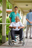 Nurse driving senior man Royalty Free Stock Images