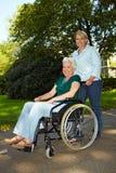 Nurse driving senior woman Royalty Free Stock Photo